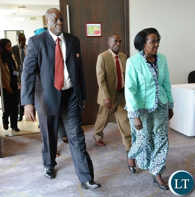Vice President Inonge Wina chats with her Deputy Minister Lowrance Sichalwe  shortly before meeting with donors at Intercontinental Hotel