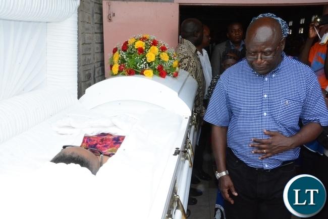 Ministry of Information Permanent Secretary Godfrey Malama body view the late ZNBC staff Faith Kandaba at the Church Service at Saint Pauls Catholic in Lusaka