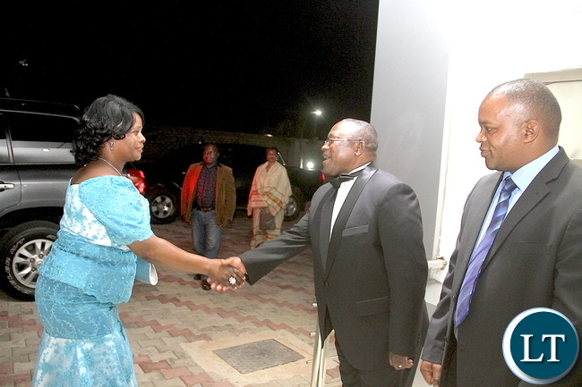 First Lady Esther Lungu being welcomed by ZAF Commander Lt Gen Eric Chimese during the wedding ceremony of Zambia Army Commander Lt Gen Paul Mihova's son Kayombo and Lucy Kalimanshi-Mihova at Chamba Valley ZAF Mess on Saturday, February 20,2016 -Picture by THOMAS NSAMA