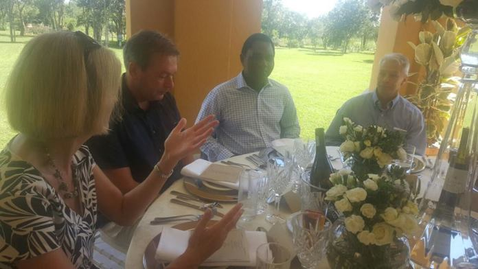 HH in deep conversation with diplomats during the luncheon