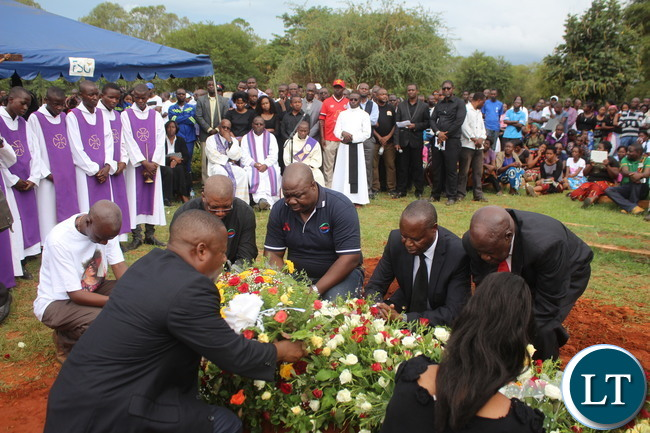 ZNBC Director General Richard Mwanza (r) and Staff lay wreaths on late ZNBC staff Faith Kandaba at the Church Service at Saint Pauls Catholic in Lusaka