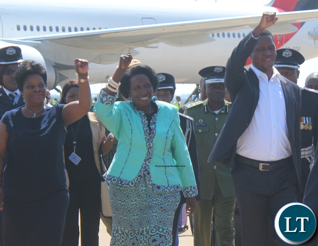 President Edgar Lungu and Vice President Inonge Wina show party symbol and the first Lady Esther Lungu (l) on his arrival at Kenneth Kaunda International Airport from France