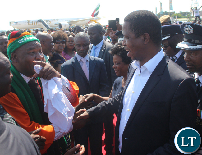 President Lungu greeting one of the people that welcomed him