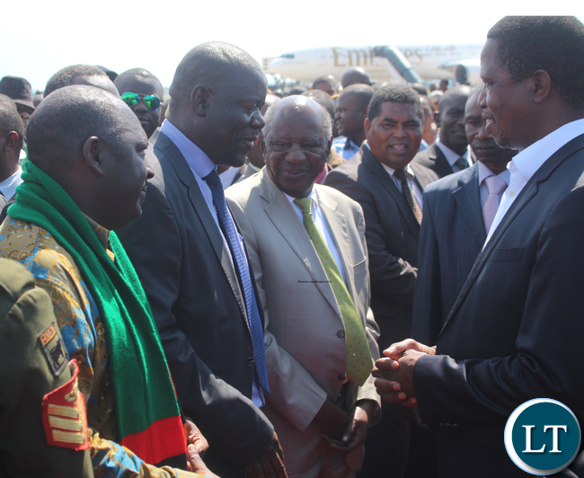 President Edgar Lungu with Minister of Home Affairs Davies Mwila while looking on are PF Secretary General Davies Chama, Minister of Finance Alexander Chikwanda