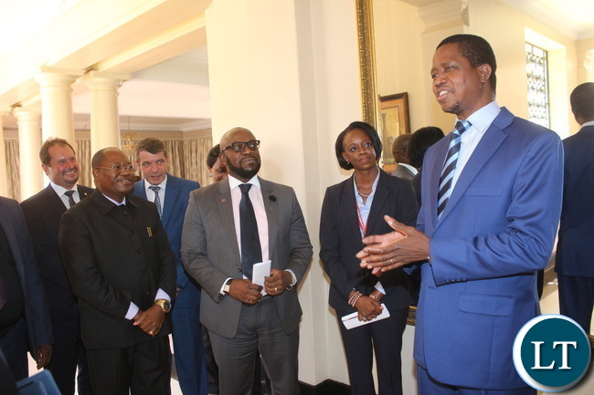 President Edgar Chagwa Lungu cracking a joke with the entourage of Bharti Airtel CEO and Chairman Sunil Bharti Mittal.