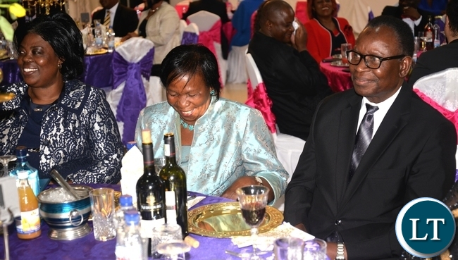 HEALTH Minister Joseph Kasonde (right), his wife, Mary (middle) with Tourism and Arts Minister Jean Kapata follow proceedings of the wedding reception of Home Affairs Minister Davies Mwila's daughter Leah, at Zambia Air Force officers' mess in Lusaka on Saturday evening