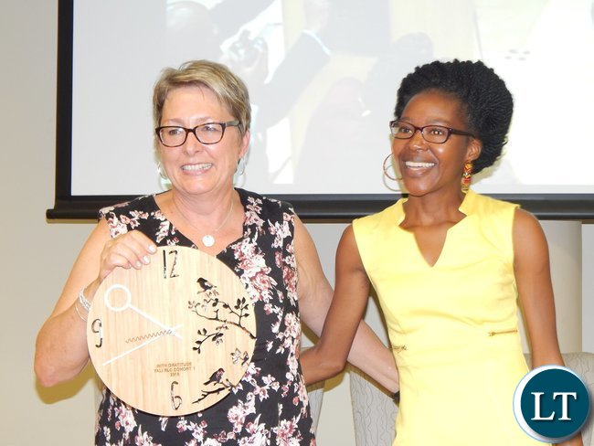 Zambia's Christabel Mwango and USAID Southern Africa Mission Director Ms. Cheryl Anderson pose for a photo at the graduation ceremony of 130 youths from the Southern African region at the University of South Africa in Pretoria on 25th February, 2016
