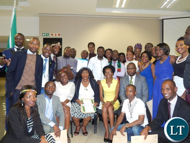 ambian High Commission First Secretary for Education Mrs. Emmerentiana Bweupe (seated in black jacket and white top) and First Secretary for Trade Mr. Mande Kauseni (seated in grey jacket and tie) with the Zambian graduates at the University of South Africa in Pretoria on 25th February, 2016