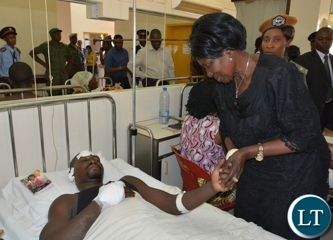 Vice President Inonge Wina comforts one of the victim from the fire fighters accident Kapambwe Phiri at Mtendere Mission Hospital in Chirundu District