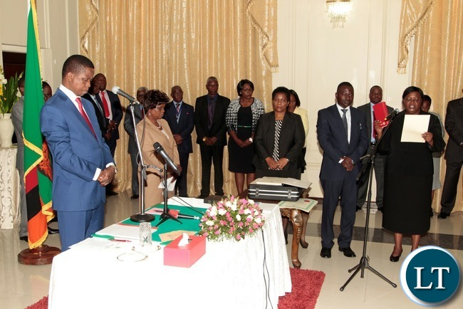 President Edgar Lungu listens to the orth from newly appointed Constitutional Court President justice Hildah Chibomba at State House