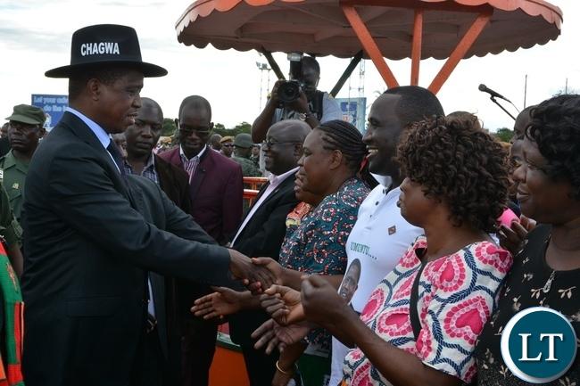 President Edgar Lungu greets people on his arrival at Simon Mwansa Kapwepwe airport