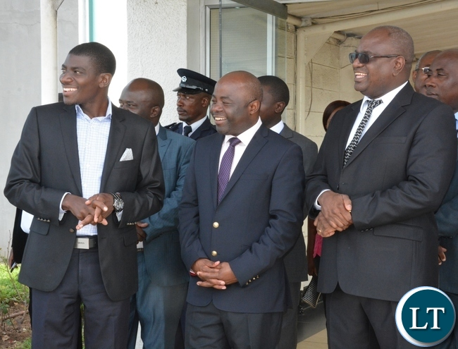 Speaker of the National Assembly Patrick Matibini(r), Minister of Local Government and Housing Stephen Kampyongo(c) and Minister of Fisheries and Livestock Greyford Monde(l) looks at the plane as it leaves at KK airport just after seeing off Chairman of the Standing committee of the National peoples congress of China H.E Zhang Dejiang at KK airport y