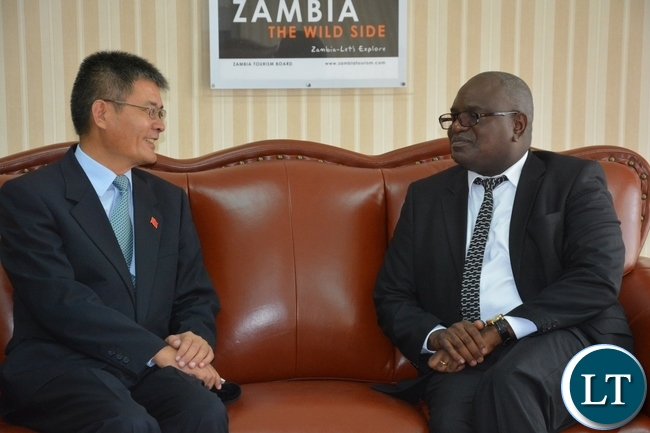 Speaker of the National Assembly Patrick Matibini(r) chats with Chinese Ambassador Yang Youngming(l) at KK airport just after seeing off Chairman of the Standing committee of the National peoples congress of China H.E Zhang Dejiang at KK airport