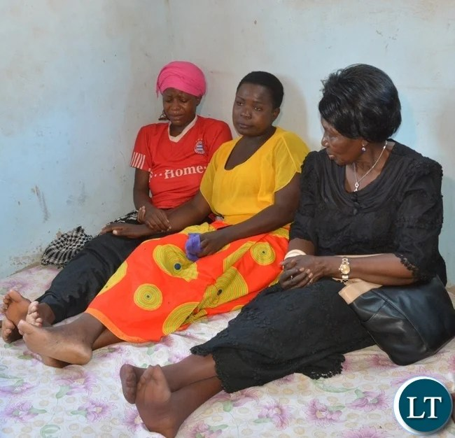 Vice President Inonge Wina(r) comforts mourners at one of the victims  from the fire fighters accident funeral house in Chirundu District