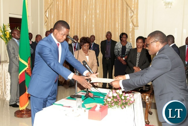 President Edgar Lungu receive the orth from newly appointed Constitutional Court judge Justice Palan Mulonda at State House