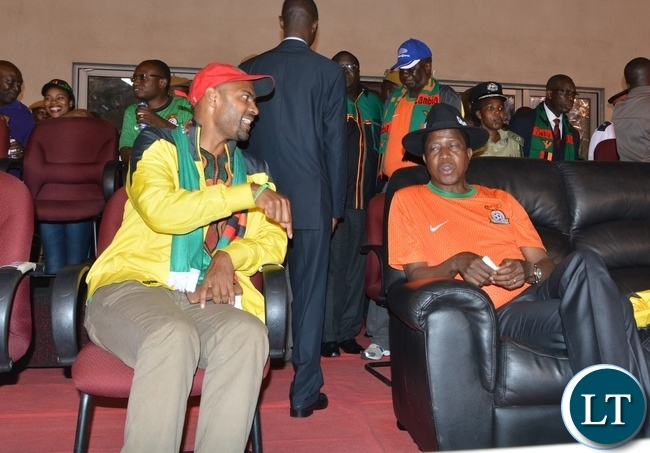 Sports and Youth Minister Vincent Mwala chats with President Edgar Lungu during the Zambia Vs Congo match in Ndola Studuim