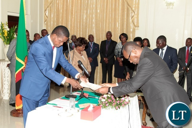 President Edgar Lungu receive the orth from newly appointed Constitutional Court judge Justice Enock Mulembe at State House