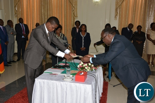 resident Edgar Lungu receive latter of Orth from Newly sworn in Supreme Court Judge Micheal Musonda at State House during the swearing in ceremony of the Supreme Judges