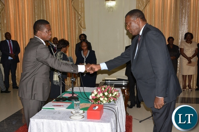 President Edgar Lungu congratulates Newly Sworn in Supreme Court Judge Justice Jones Chinyama at State House during the swearing in ceremony of the Supreme Judges