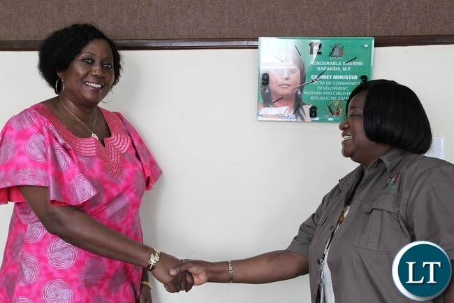 Minister of Community Development and Social Welfare,Emerine Kabashi being welcomed by Assistant Director information and Communication on decentralisation,Coreen Mvula in Lusaka