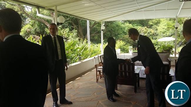 Wynter Kabimba shakes hands with western diplomats
