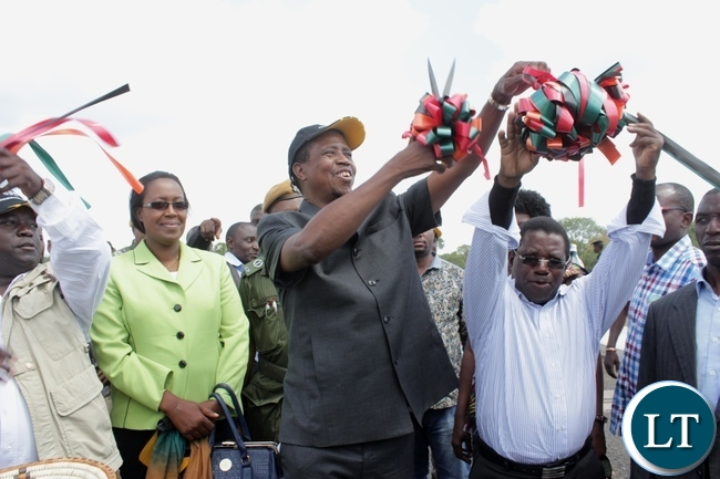President Edgar Lungu (c) cuts the ribbon to officially commission the Sioma Bridge built at a cost of K108.2million in Sioma District of Western Province