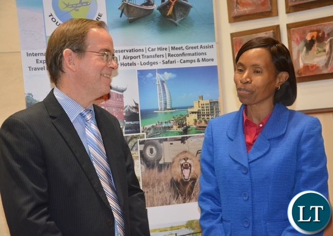 Commerce Permanent Secretary Kayula Siame(r) chats with U.S Embassy Deputy Chief of Mission David Young(l) during the American Chamber of Commerce Annual General Meeting at the American Embassy