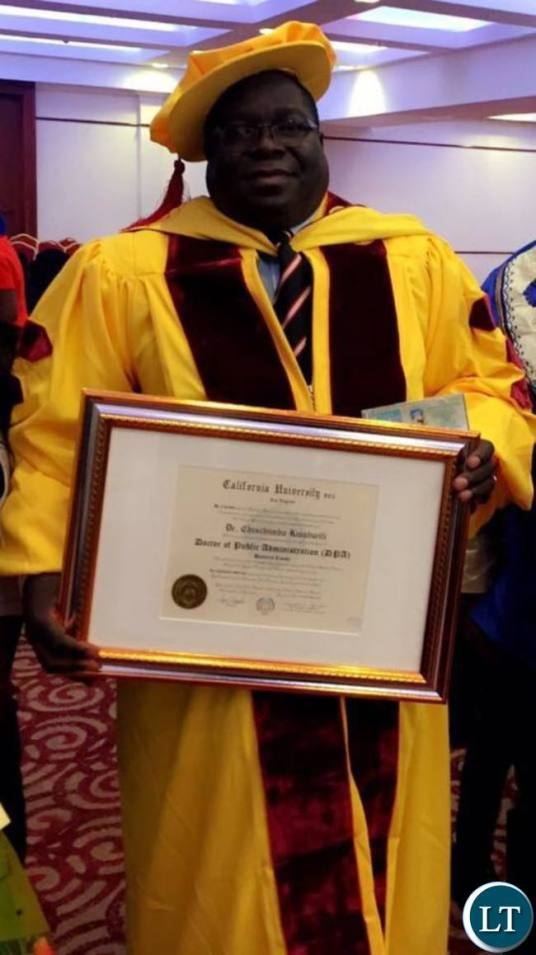 Dr Kambwili displays the doctorate degree awarded to him by the University of California