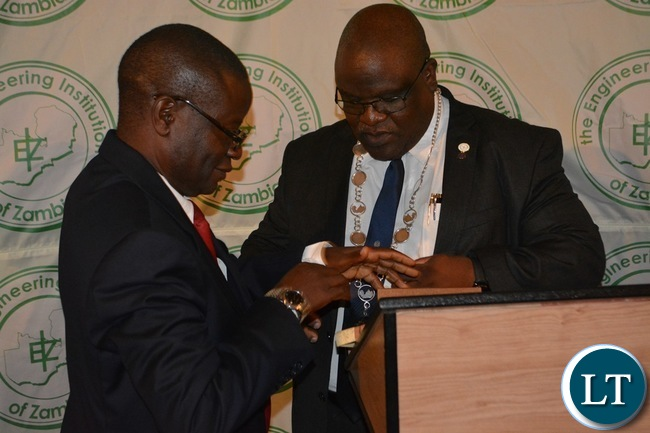 .Outgoing EIZ president Bernard Chiwala (left) hands over the instruments of power to newly elected EIZ president George Sitali (right) during the EIZ gala dinner at AVANI Victoria Falls Hotel in Livingstone