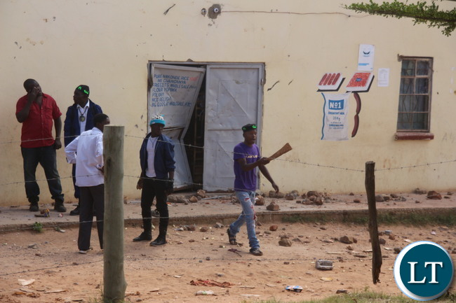 Looting of Rwandese Refugees owned shops in Mtendre East  behind the Jehovah's witness Kingdom hall, with PF cadres trying to stop the looting