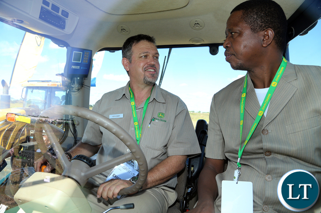 President Edgar Lungu with Mr Kelvin Lesser on John Deere Tractor at Agrictech Expo 0882