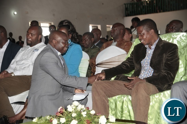 President Edgar Lungu shakes hands with Reverand Sams Kafundang when he attended a church service at Blesed of Hope Church