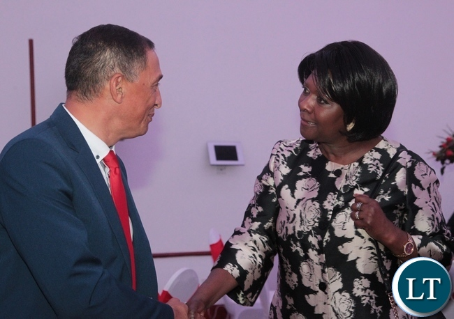 Minister of Commerce,Trade and Industry Margaret Mwanakatwe(r) talks to Adam Essa of STAG African Limited(l) during the launch of the Zambian Chapter of Zambia-South Africa Business Council at Pamodzi Hotel in Lusaka