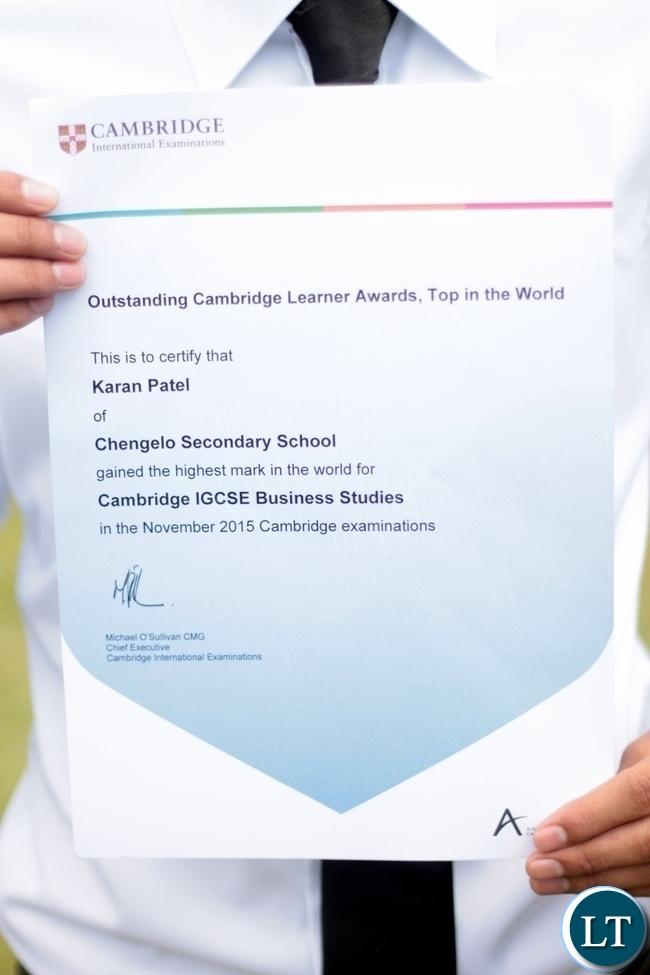 Karan shows off his certificate