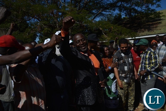 FORMER United Party for National Development (UPND) Zambezi ward Councilor Philimon Musonda flashes a PF symbol after defecting to the ruling party in Livingstone. Picture by KELVIN MUDENDA