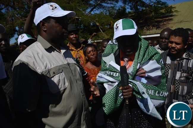 PF parliamentary candidate Omar Munsanje (left) welcomes FORMER United Party for National Development (UPND) Zambezi ward Councilor Philimon Musonda (Right in PF chitenge) during the defection ceremony in Livingstone .Picture by KELVIN MUDENDA