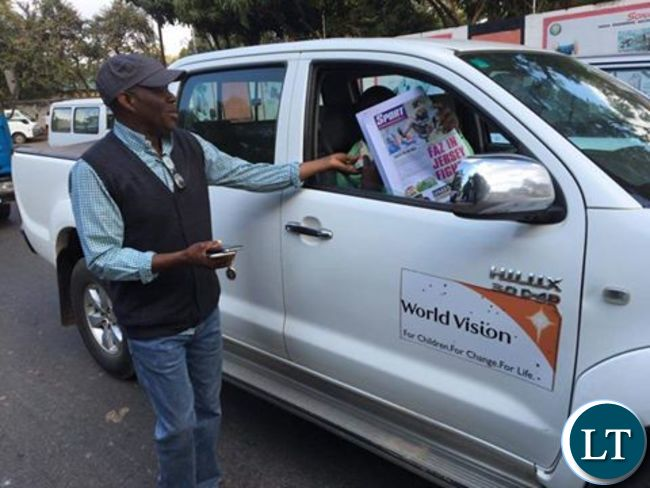 Fred Mmembe sells Post copies on the streets of Lusaka