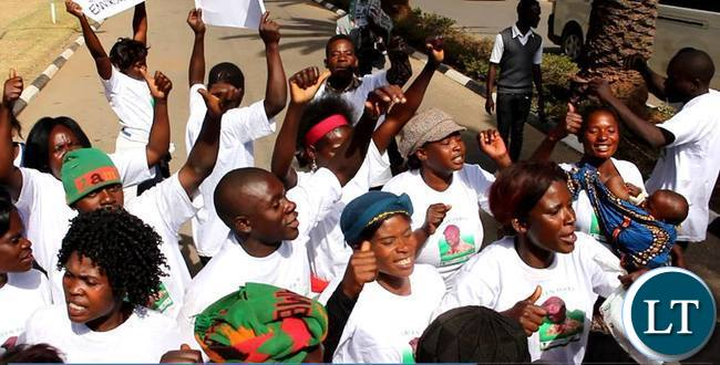 Green Party members march into Mulungushi Conference Centre during the filing in of presidential nomination papers