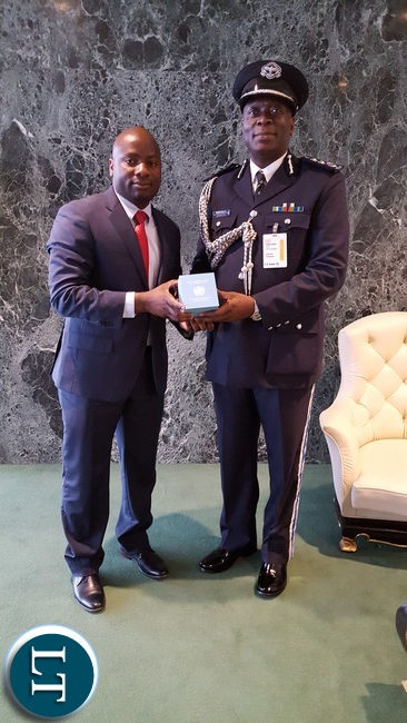 3. Zambia UN Mission's Chibaula Silwamba hands over the Dag Hammarskjold medal to Zambia Police Inspector General Mr. Kakoma Kanganja. The UN posthumously awarded the medal to Zambia Police Inspector Nathan Mutamfu, who died in Liberia during a UN Peacekeeping operation on 23 February 2015. Photo | Zambia UN Mission Press Office