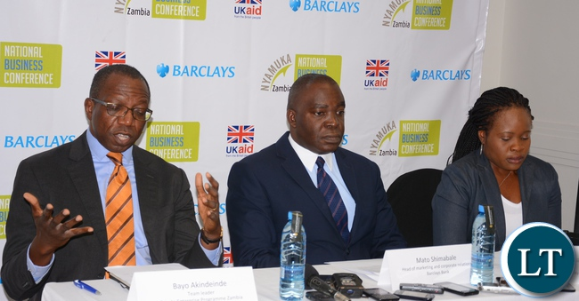 Private Enterprise program Zambia Team Leader Bayo Akindeinde(l) stressing out a point to Journalists while Head of Marketing and Corporate Relations Barclays Bank Mato Shimabale(c) and Nyamuka Zambia Business Plan Competition Officer Namaya Lewanika(r) looks on during a press briefing at intercontinental Hotel in Lusaka