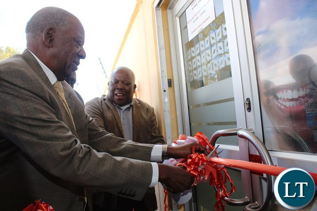 Finance Minister Alexander Chikwanda cuts a ribbon to officially open the first ever financial institution INDO Zambia Bank in Mungwi district.