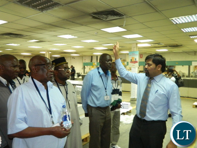 Al Ghurair Printing and Publishing General Manager Lakshmanan Ganapathy explains the printing process in the plant to the Zambian team which is in Dubai to observe the printing of ballot papers for the August 11, 2016 general elections.