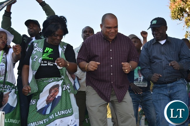 Tourism and Arts minister Jean Kapata,Livestock and Fisheries deputy minister Lawrence Evans and PF Livingstone District vice chairperson John Mukosho dancing to Dununa reverse during a PF rally at Maramba Old People's Home grounds in Livingstone