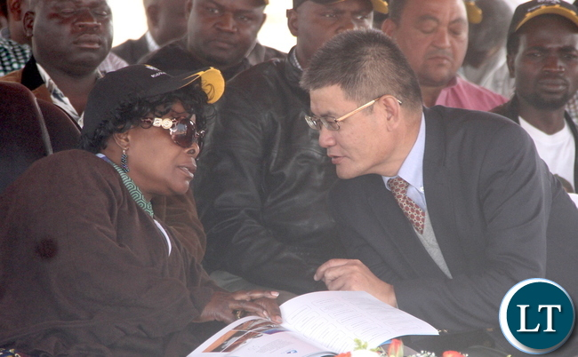 First Lady Esther Lungu speaks with Chinese Ambassador to Zambia Yang Youming during the Commissioning of Mansa-Luwingu Road in Luwingu on Monday, July 18,2016 –Picture by THOMAS NSAMA