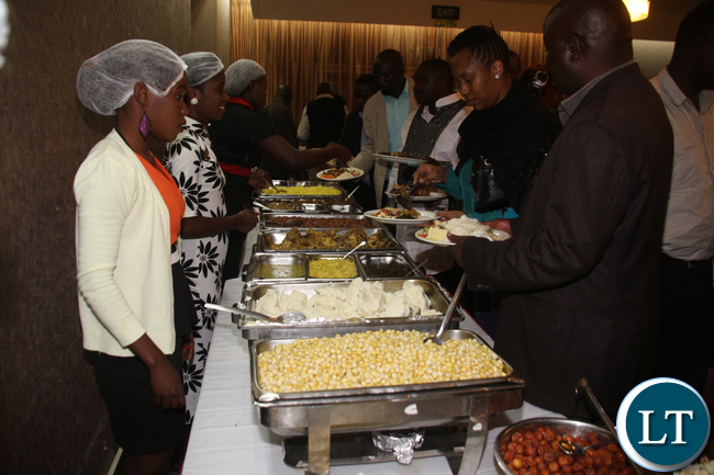 Patrons sampling the Chewa traditional