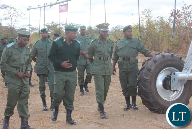 Zambia Correctional Service Commissioner Percy Chato (center) with his officers inspecting the newly procured center pivot at their farm in Kabwe during the tour of developmental projects.