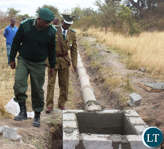 Zambia Correctional Service Commissioner Percy Chato checking on the quality of work of the sewer line under construction at Mukobeko Maximum prisons camp in Kabwe when he inspected development projects.