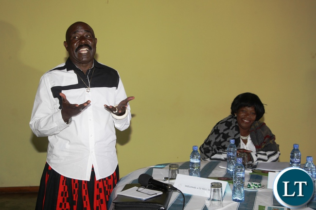 Chief Mumena of Kaonde speaking people of solwezi addressing participants to officialy open the midwives high level meeting.looking on is the Midwives association of Zambia President Genevieve Musokwa