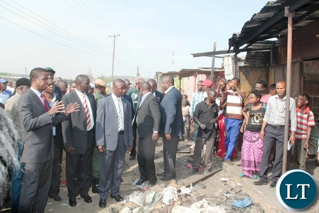 President Edgar Lungu inspects the shops burnt down by suspected UPND cadres at Bauleni Market