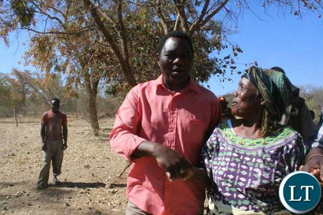 HH enjoys a light moment with his mother at the  village